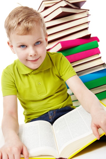 Boy sitting with books