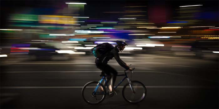 delivery guy with backpack on bike
